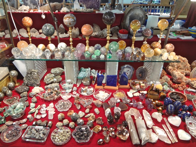 Dealer booth displaying rare crystals, minerals, and spheres at the Portland Regional Gem and Mineral Show.